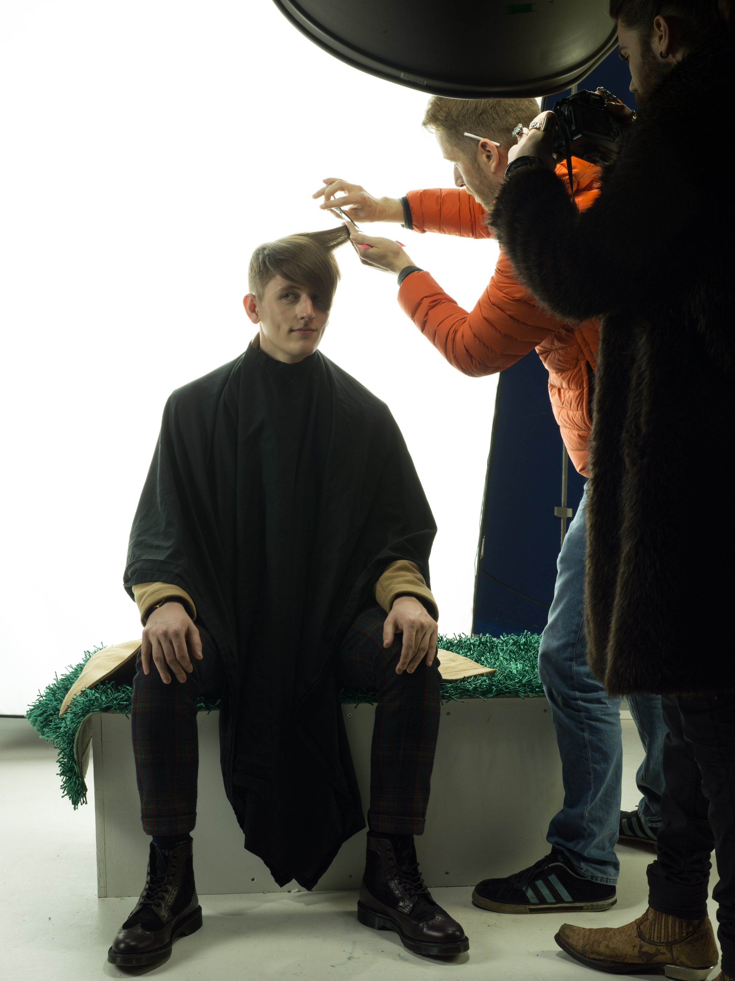 Finishing touches to model Jake's hair by Carl