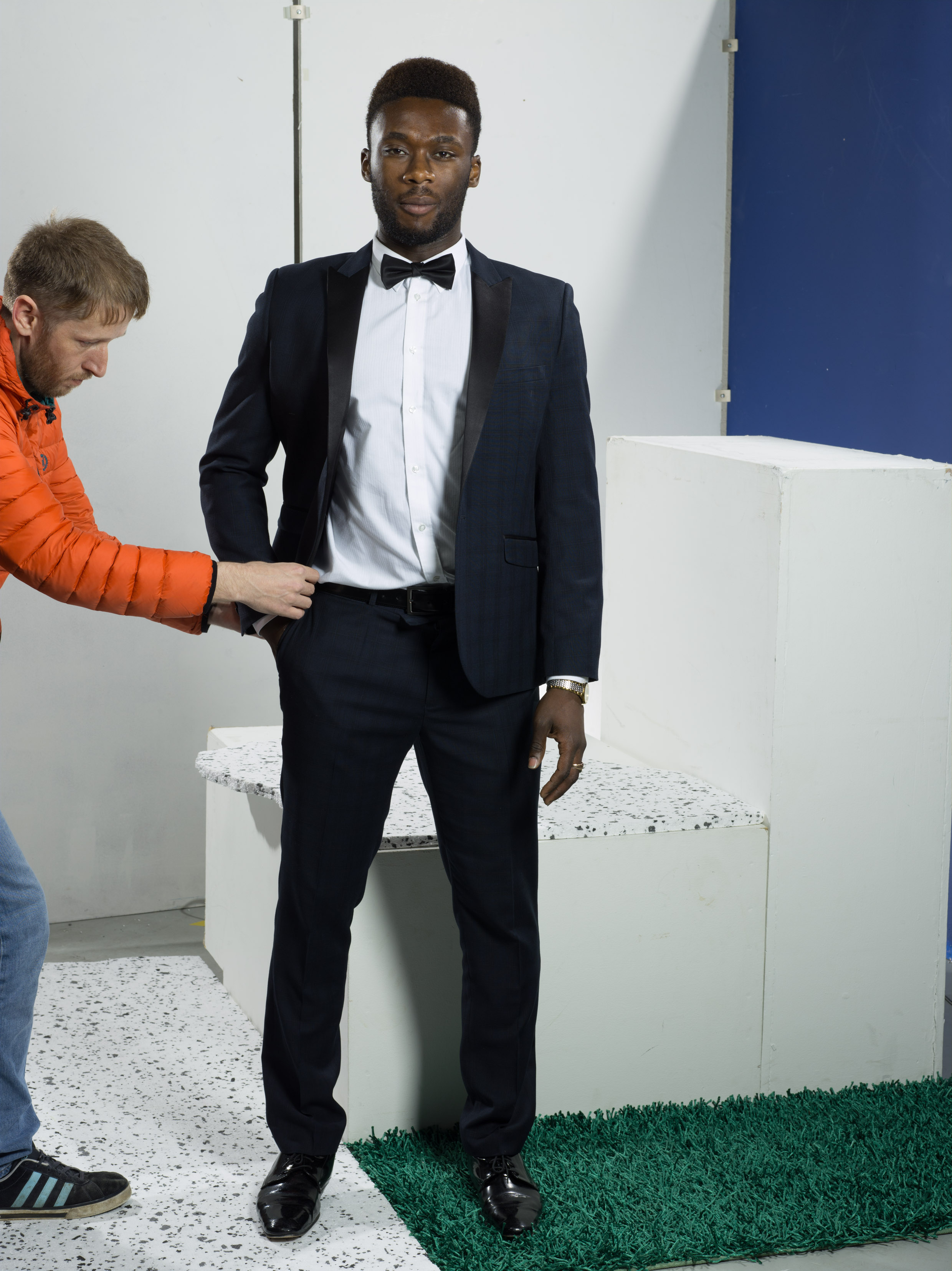 Carl perfecting model Jemal's suit